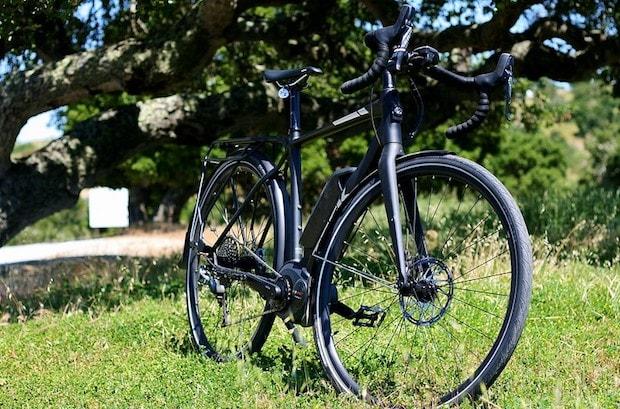 A Trek e-bike parked in the grass