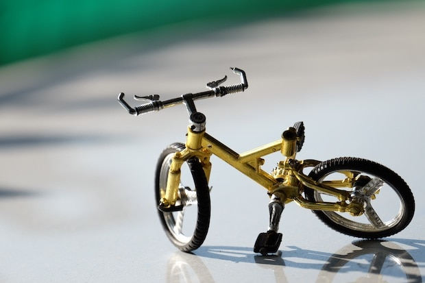 A miniature bicycle on a counter
