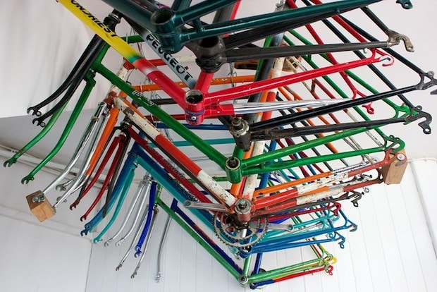 Bicycle frames hanging on a rod