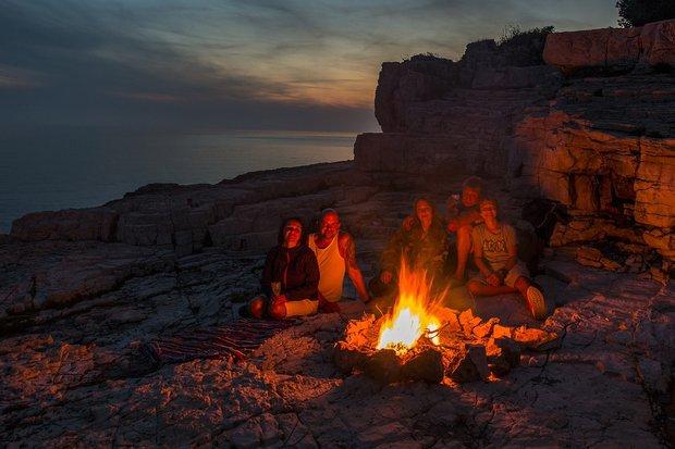 Sitting Around Campfire Making Popcorn