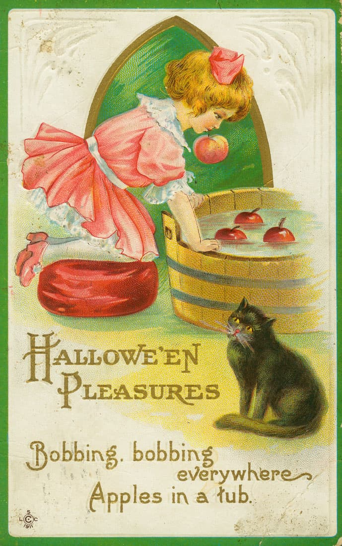 Girl bobbing for apples with a black cat watching, 1911.  Missouri Historical Society.