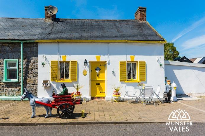 Munster Vales Ireland Travel Guide. Photograph of traditional Irish cottage. Kilmallock travel guide.