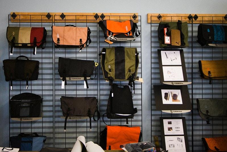 A wall of messenger bags at the Timbuk2 factory store