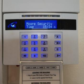 Alarm panel Lutterworth lit up on wall
