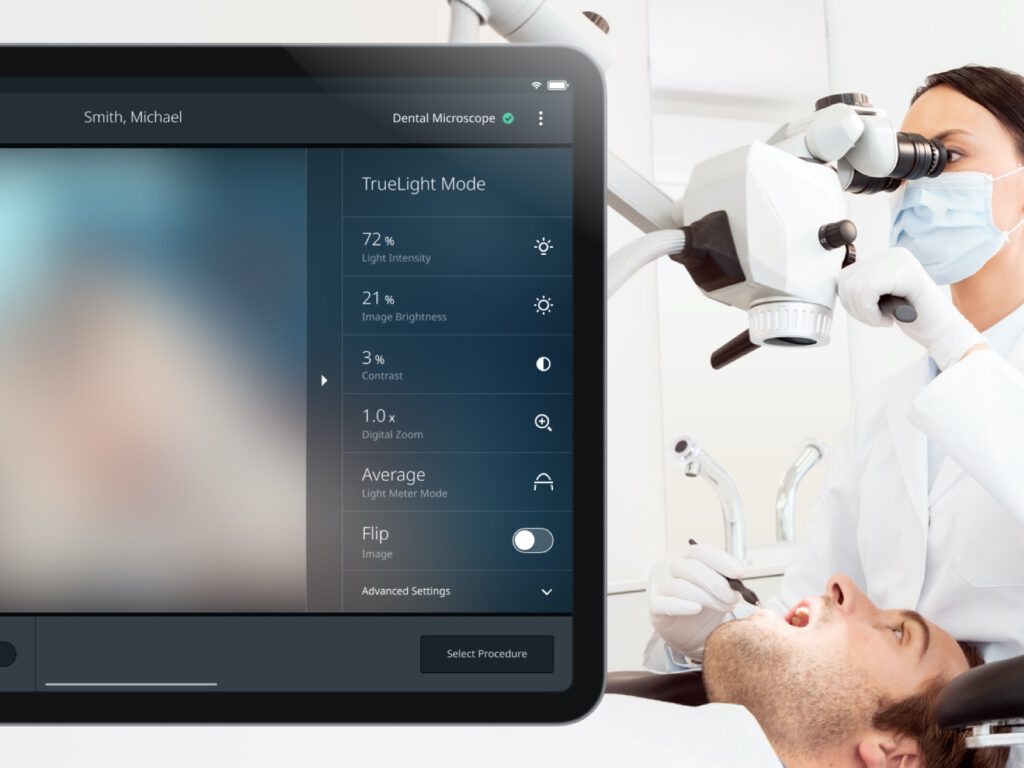 Dentist uses the iPad app to control the surgical microscope