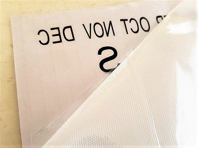 Placing transfer paper on weeded vinyl FREE SVG fileand instructions