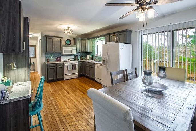 Photo of Beautiful Custom Kitchen with Grey Cabinets and Hardwood Floors