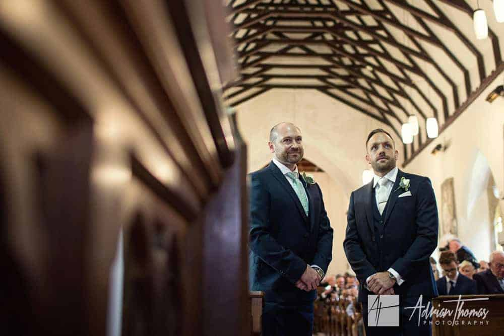 Image of groom and best man awaiting bride at St Brynach Church in Llanfrynach Brecon