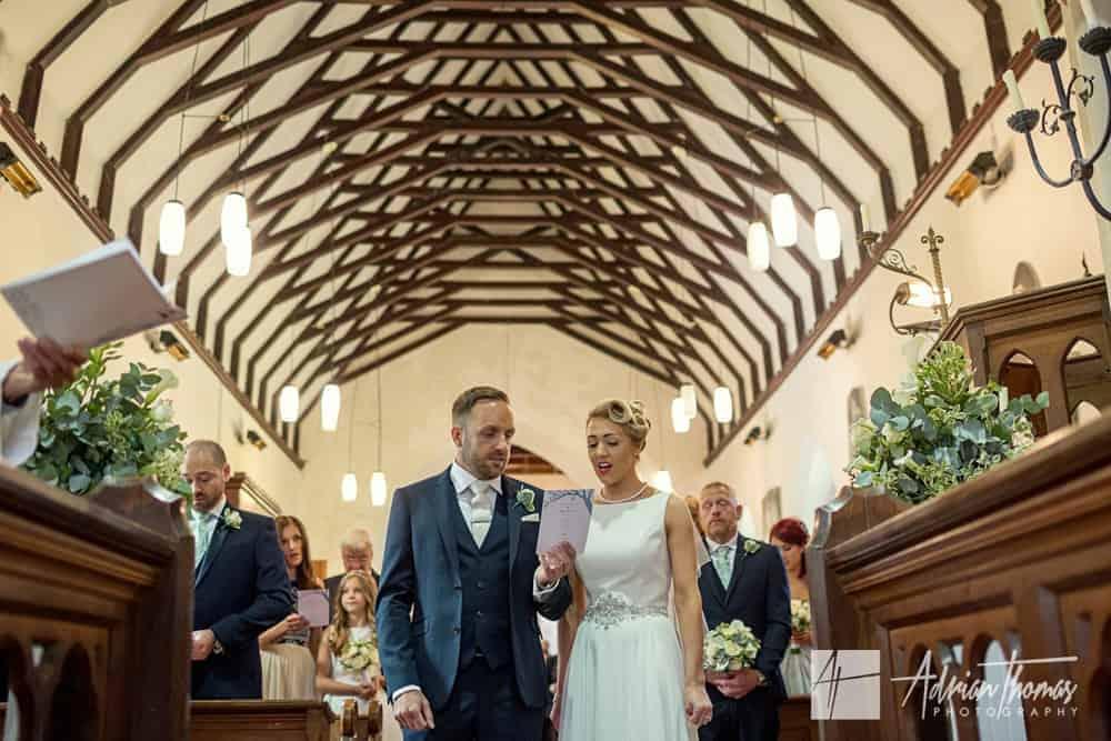 Wedding couple singing SSt Brynach Church in Llanfrynach Brecon