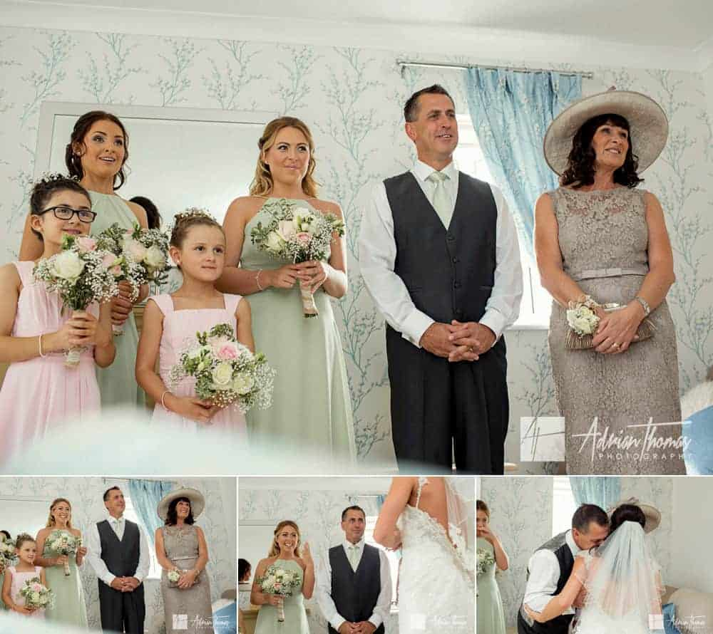 Parents first glance at bride in dress.