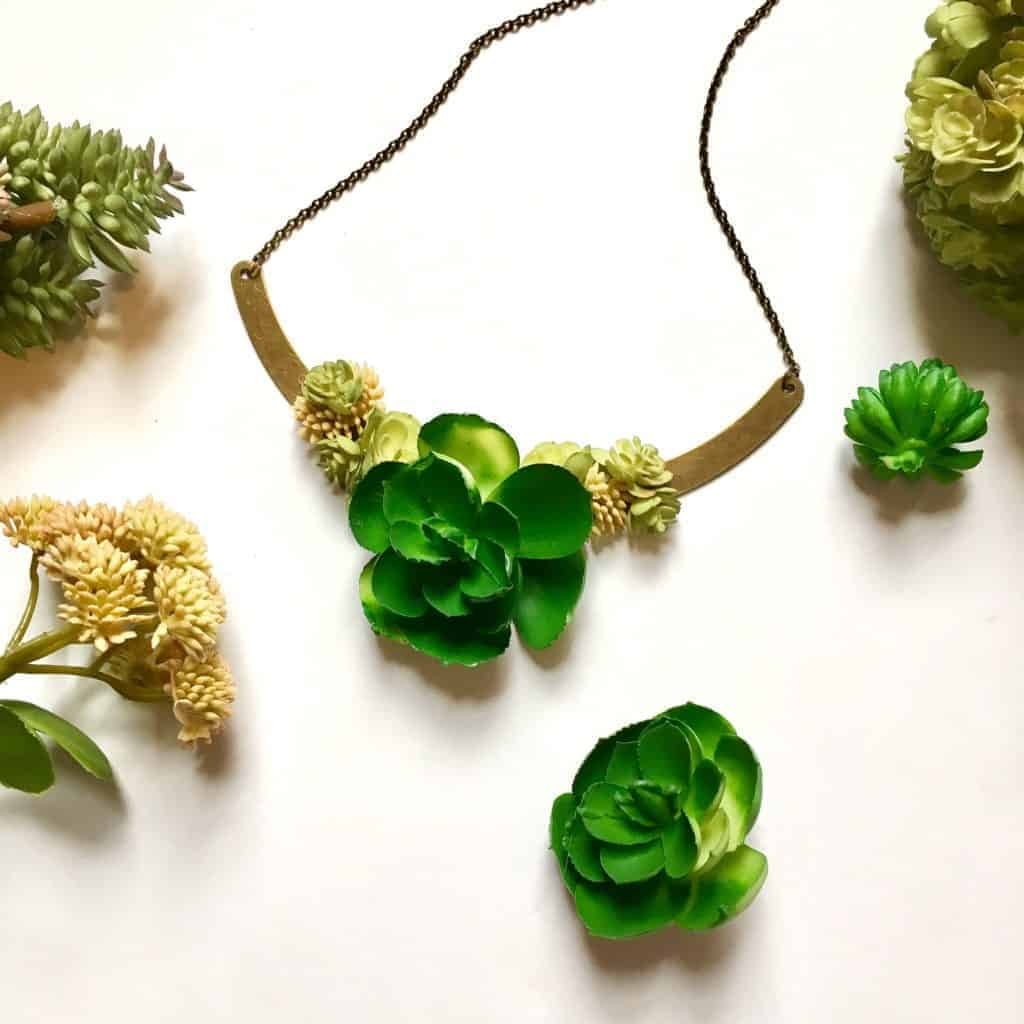 succulent necklace on a white table