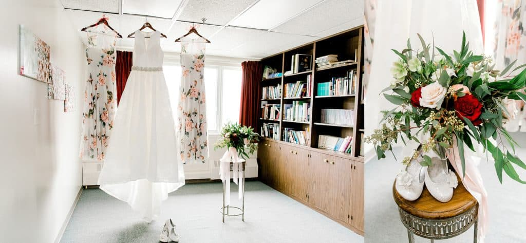 wedding dress with bridesmaids dress hanging from the ceiling