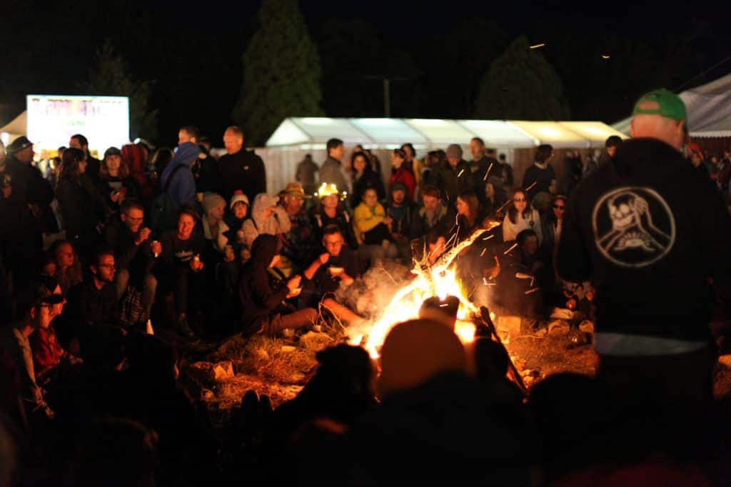 people grouped around a fire at a festival for calendar of events for valentines-liquorice.uk