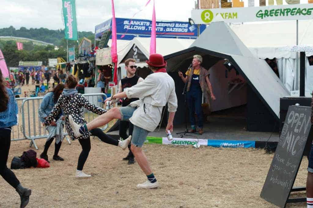 Revellers dance at Glastonbury festival with Saint Valentines Liquorice Company