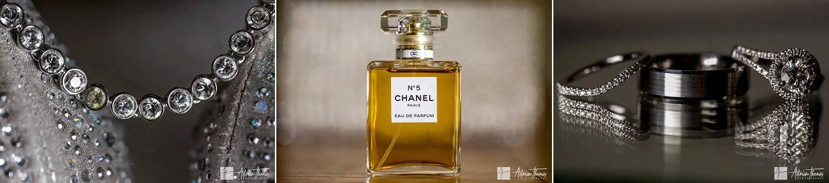 Image of wedding rings, jewellery and perfume bottle.