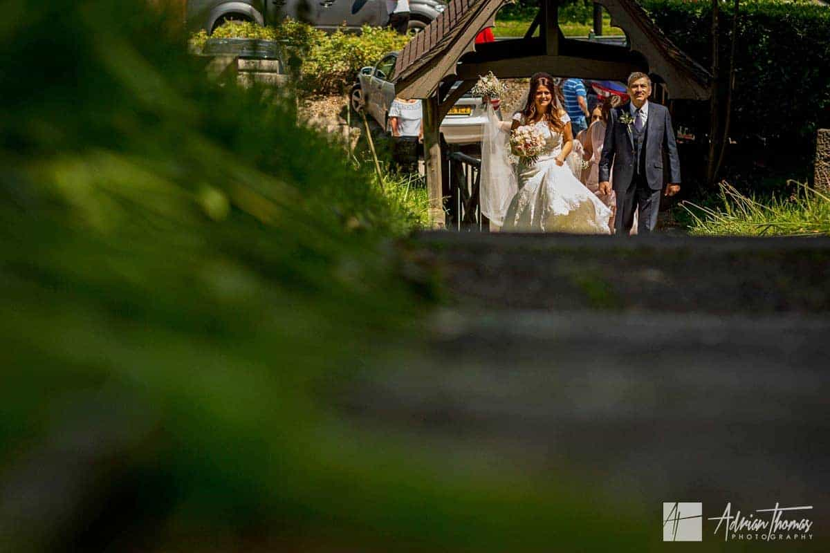 Bride and her father walking up Ystrad Mynach Church path.