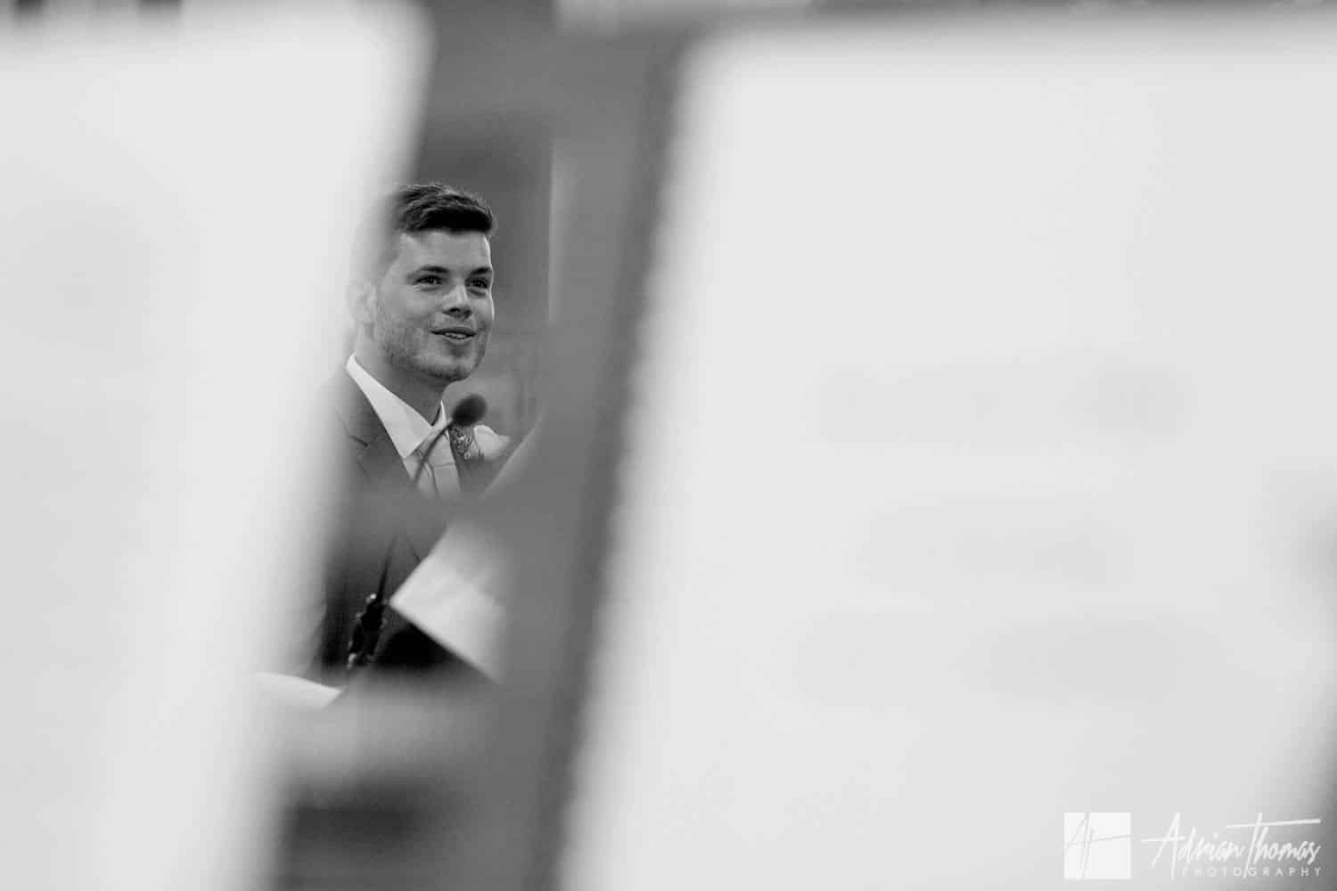 Groom smiling during his ceremony in church.