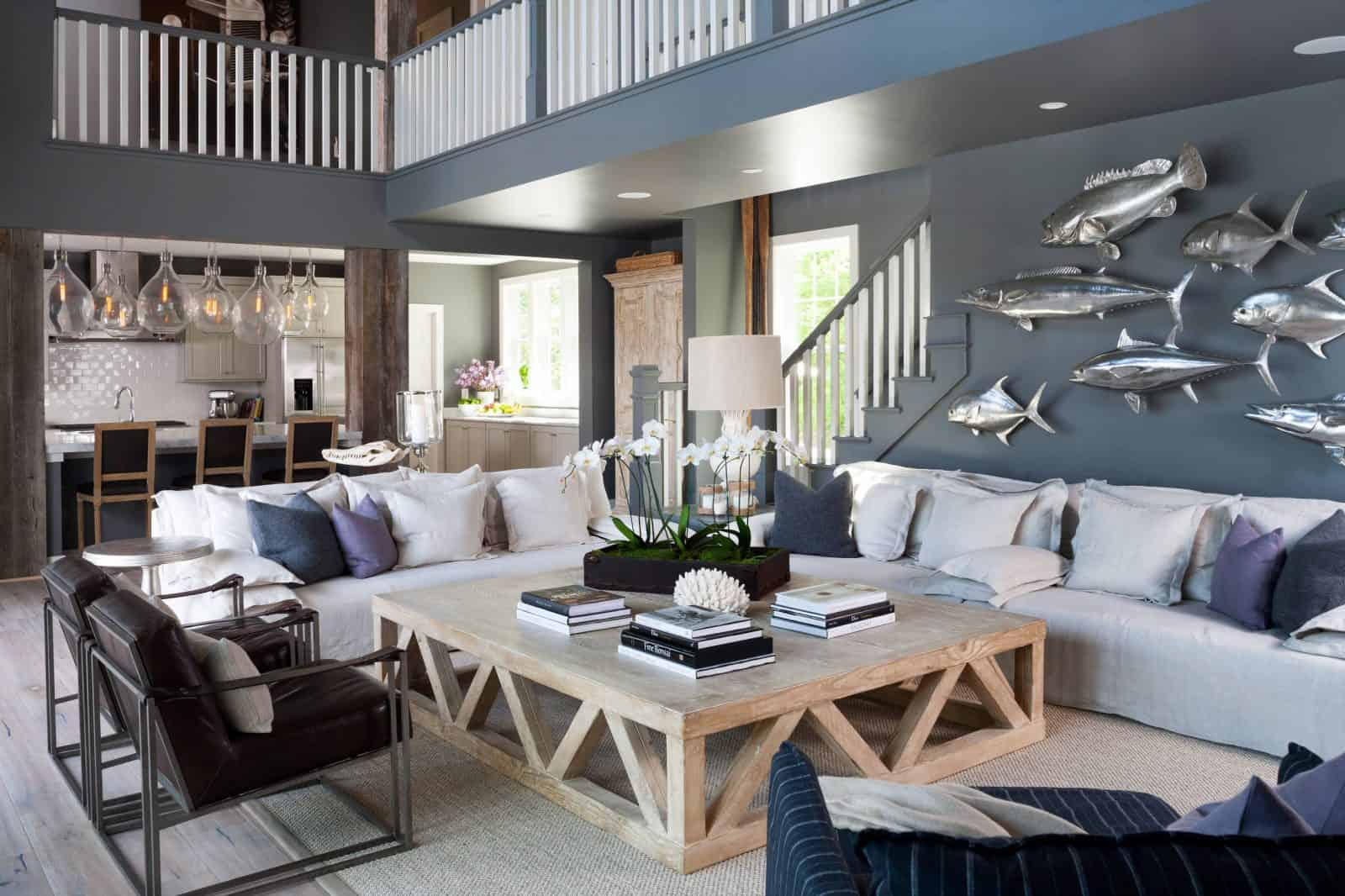 grey and blue open living room with a blue-grey wall