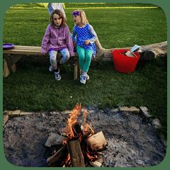children by campfire