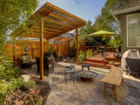 combine pergola with metal roof and various bamboo elements for calming japanese retreat vibes