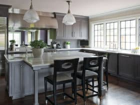 complement grey-stained walnut cabinets with dark wood floor for a classically elegant eat-in kitchen