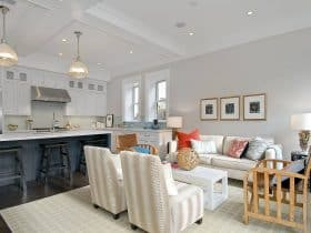 open-style traditional kitchen and living room with Benjamin Moore balboa mist 1549 warm gray wall paint color