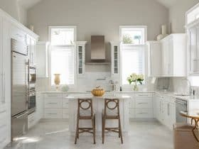 mediterranean kitchen with white cabinets and greige Sherwin Williams SW 7647 Crushed Ice wall paint color