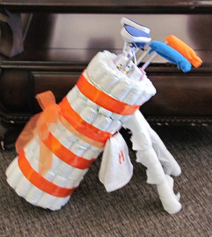 Golf Bag Diaper Cake. 15 Creative Diaper Cakes. Amazing Baby Shower Party Ideas, crafts and homemade gifts.