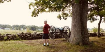 A man takes in the gettysburg battlefield from seminary ridge.