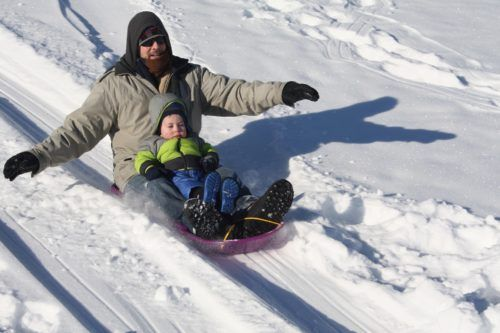 You can go sledding on a family winter vacation