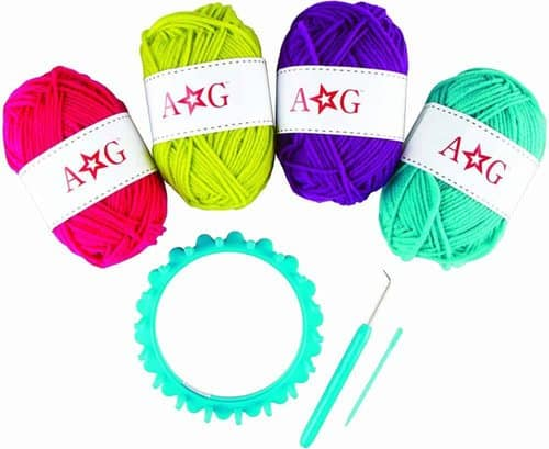 """American girl's """"knitting"""" kit comes with 4 colors of wool, a loom, hook and needle."""