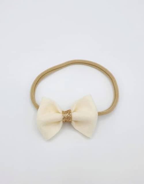 Nylon haarbandje met dubbele witte sparkle strik
