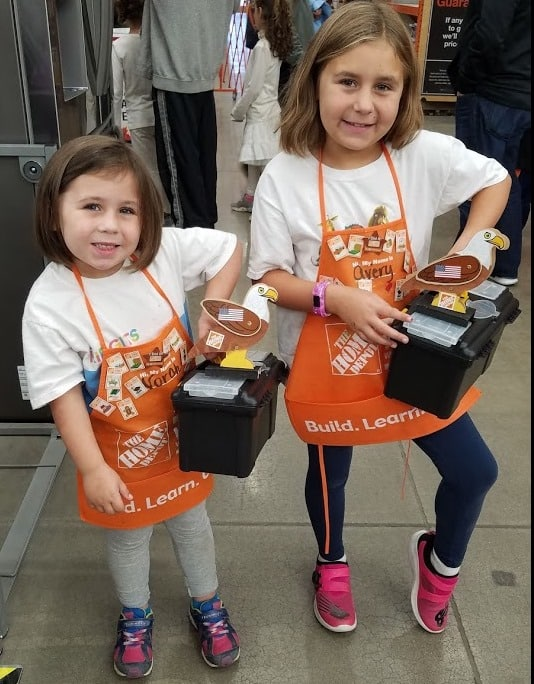 Image of the MacAloney girls with their toolboxes.