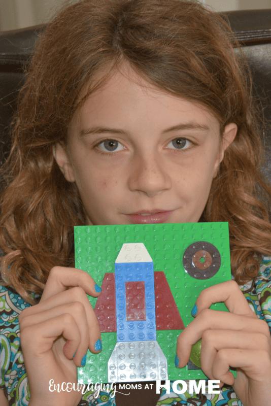 Anna, age ten, displays her LEGO Art.