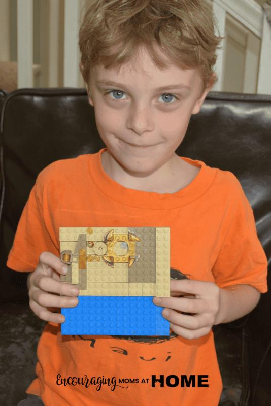 Caleb (age six) displays his LEGO Art.