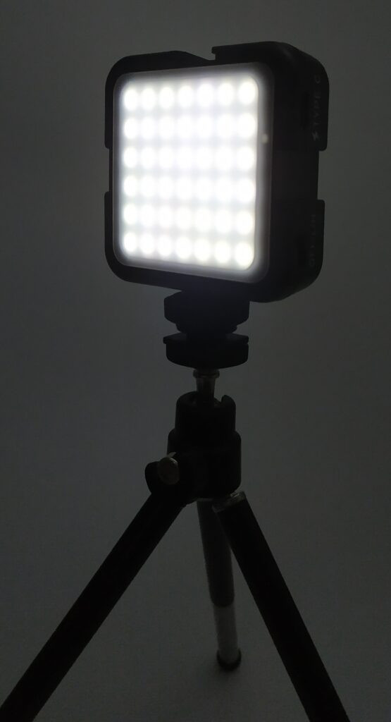 Image shows the light on the tripod, the light is powered on.
