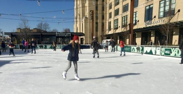 A seasonal ice rink in landrmark park near fenway park.