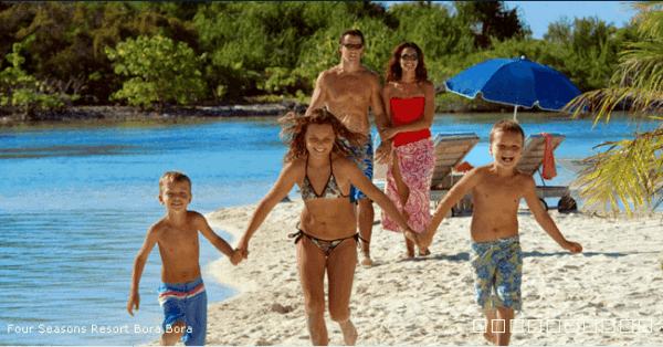 A family on the beach in bora bora