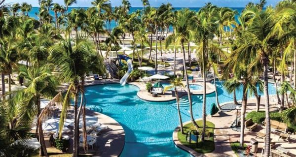 The hilton in ponce is a sprawling resort with family amenities like a large pool with a slide.