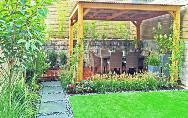 create a secluded dining area with ipe wood deck, cedar fencing, and shaded metal roof