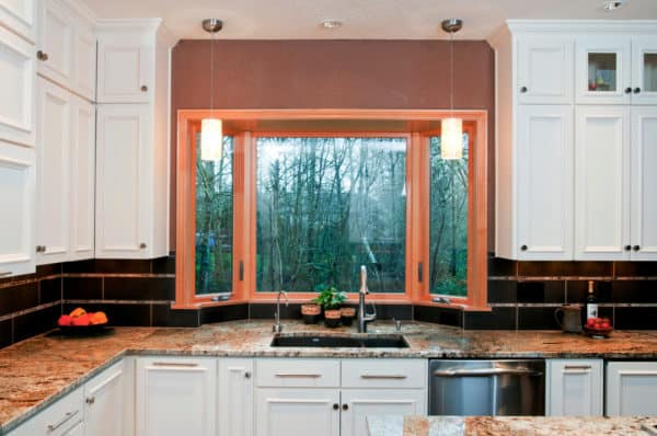 try a 6-feet wooden bay window along with a traditional u-shaped kitchen setup
