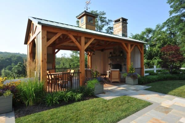 use ponderosa pine siding and metal roof pergola for a charming farmhouse deck