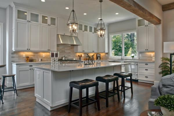 add captivating light fixtures to glow warmly on stainless appliances and white cabinets