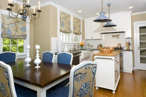 farmhouse style kitchen with muted yellow and steel blue furniture