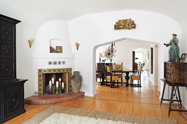 tuscan wood floor as backdrop for earth-tone tiles in front of corner fireplace