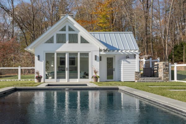 build an all-white pool house with bathroom and second living room for the ultimate pool experience