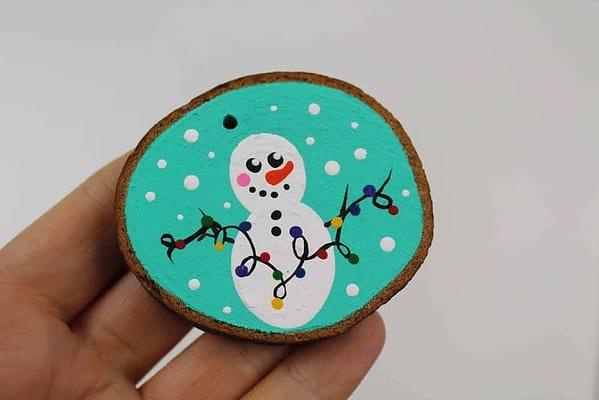 hand holding a snowman ornament