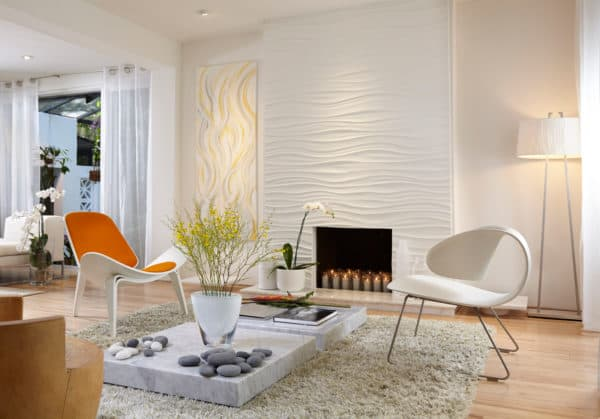 elevated marble tile in front of fireplace in a bright and airy living room