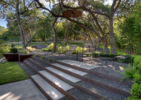 roadside landscaping makes use of rustic corten steel for the retaining walls