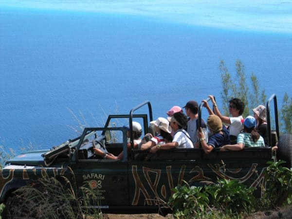 A family on a 4x4 jeep safari on bora bora. Amazing views.
